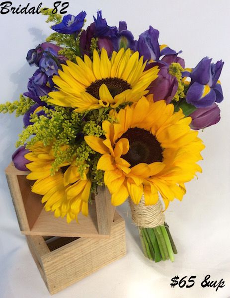 sunflower wedding bouquets ideas this bridal bouquet is 65 sunflowers iris tulips 7829