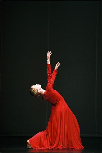 Pina Bausch's Orpheus and Eurydice. Pip: Red dress with fitted sleeves.