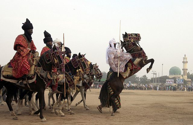 Hausa people doing their traditional horse dancing show on an Islamic Holiday Durbar.