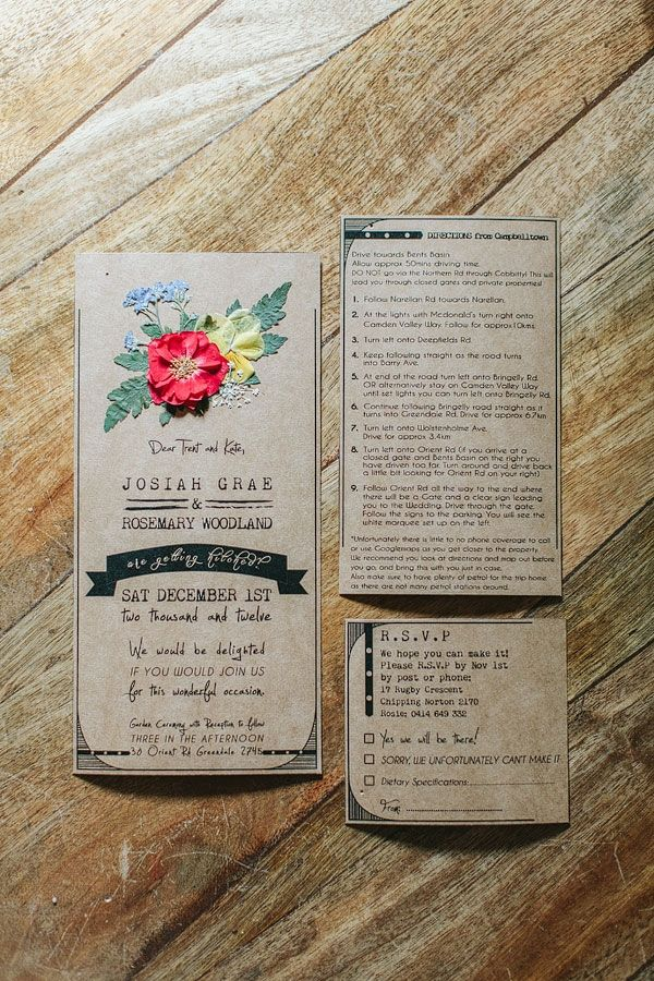 kraft invitations with pressed flowers // photo by I Love Wednesdays