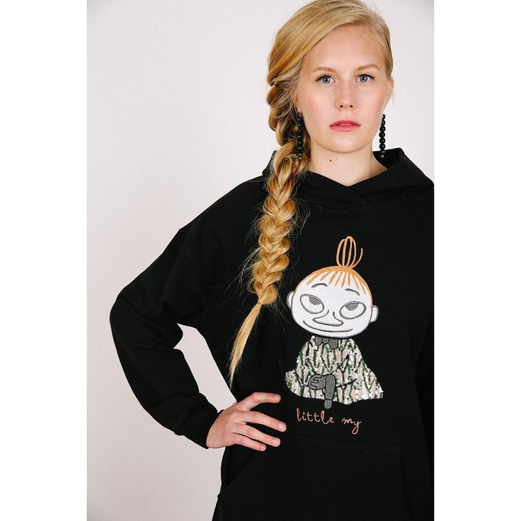 A black hoodie sweatshirt from our Moomin clothing line features an embroidery of Little My with a glittering dress. The stylish hoodie is plain black