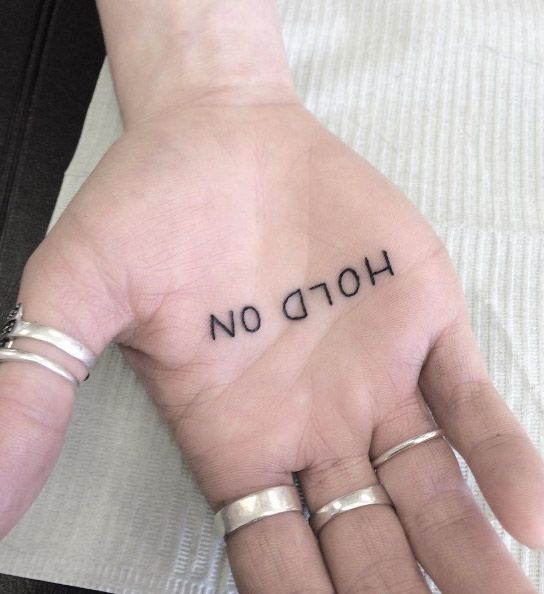 'Hold on' palm of hand tattoo by Rachelle Gammon