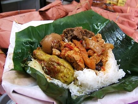 OK Indo Food Store, 88-15 Justice Ave., Elmhurst, 718-606-0104, where Tante Santi Su and her sons hawk several kinds of nasi bungus—a complete meal, including rice—wrapped  in a banana leaf to locals on their way home from church. The green parcels are then further wrapped in butcher paper and bound with a rubber band. It's some mighty fine Surabayan home cooking and a steal at $6.50 for white rice or $7.50 for yellow. Take note it's only available Sunday afternoons