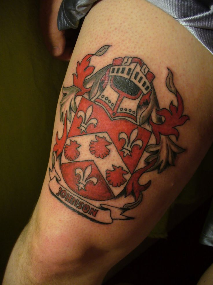 Red Ink Family Crest Tattoo On Thigh