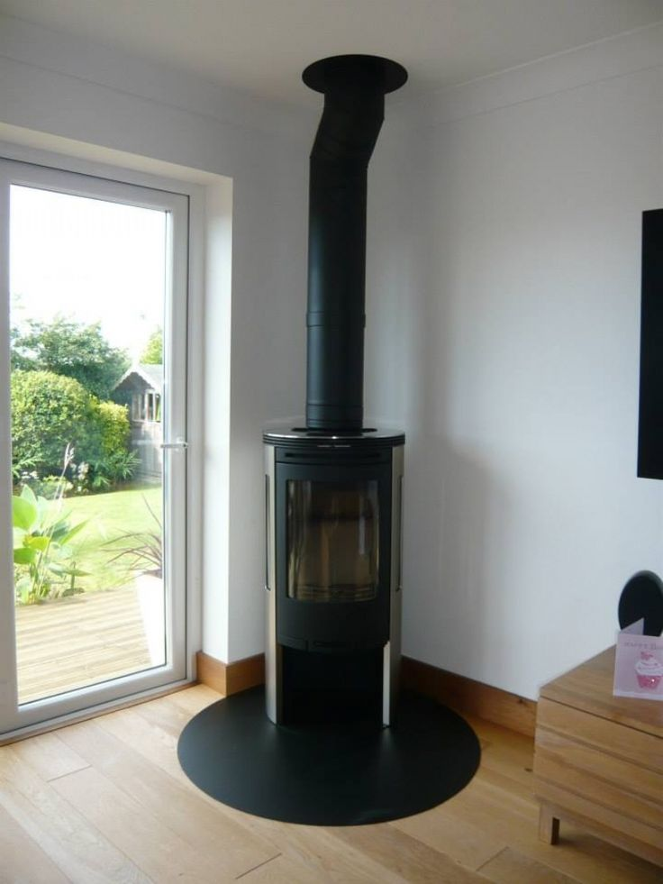 The Contura 655 with it's reflective side panels looks amazing in this setting, and our bespoke circular hearth finishes it perfectly. Installed by Kernow Fires in Cornwall. #contura #stove #fire #wood #burner #modern #contemporary #lounge #living #room #bespoke #circular #hearth #kernowfires #wadebridge #redruth #cornwall