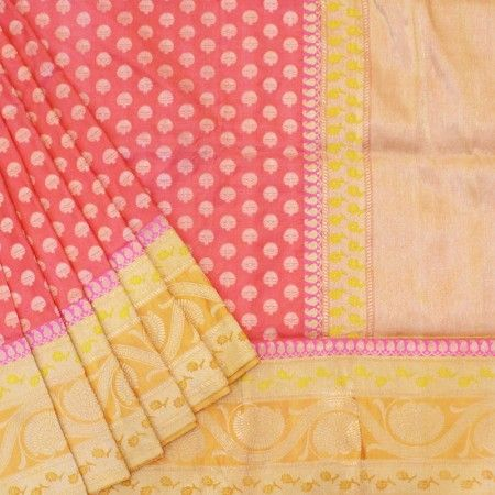 Tangerine orange coloured banarasi saree with tree motif in gold zari all over the base.Light mustard base border has floral and paisley bel in yellow and pink.