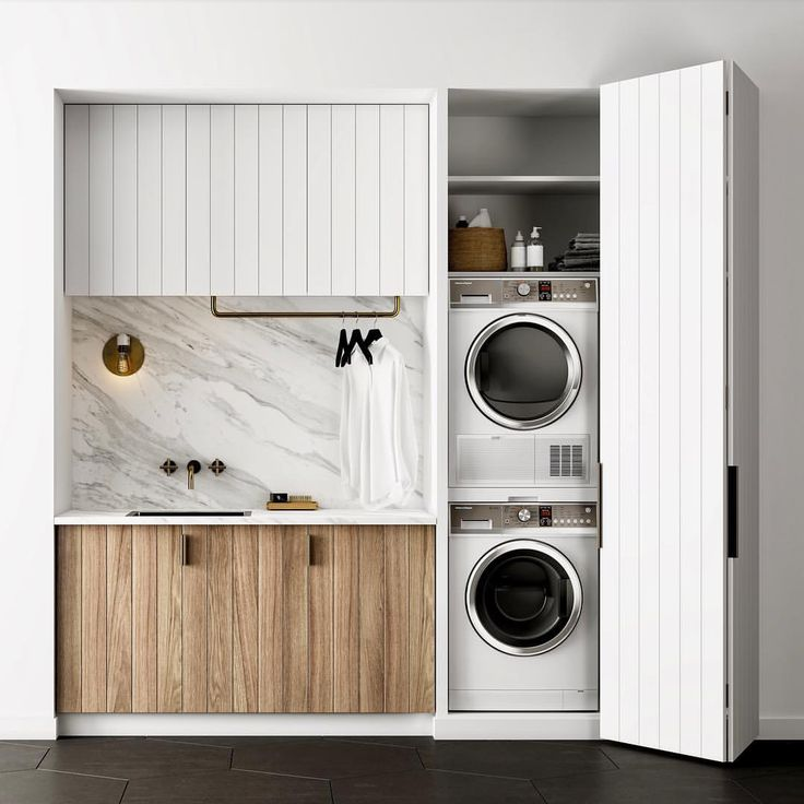 Micro laundry with black tiles and marble countertop