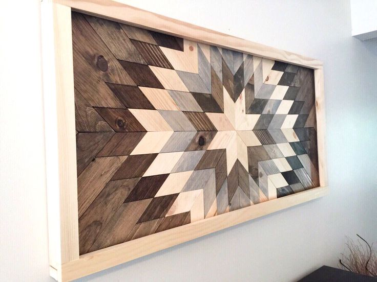 "This is a handmade wooden wall mosaic made from upcycled wood. Each piece is hand cut and arranged into this beautiful sunburst to be enjoyed for many years to come. Dimensions: approximately 24"" x 48"