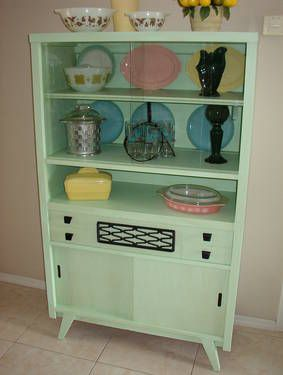 Vintage 1950S China Hutch. I like the way this has been painted up. Beautifully sets off the pastel colors of the dishes.