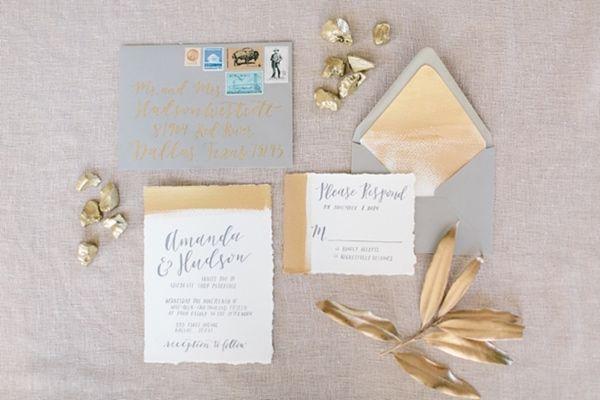 gold and grey invitations - photo by Amanda Jameson Weddings http://ruffledblog.com/modern-wedding-inspiration-with-grey-and-gold