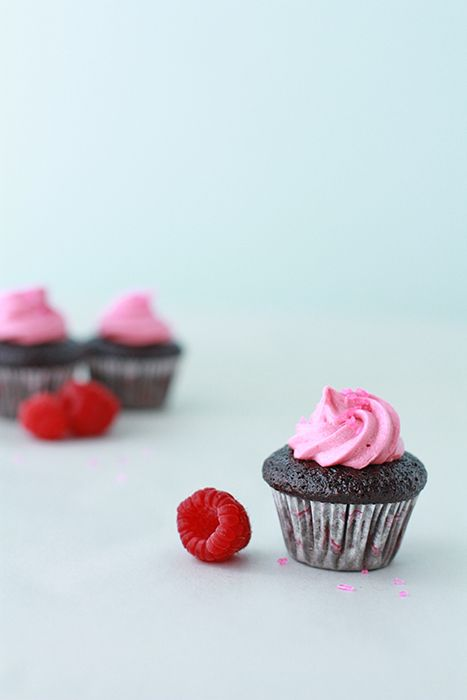 A recipe forchocolate cupcakes with raspberry frosting - the frosting is made by reducing a raspberry puree to a very concentrated raspberry syrup. This way you can add raspberry flavor without the water. The chocolate cupcakes are a simple one-bowl chocolate cake recipe.