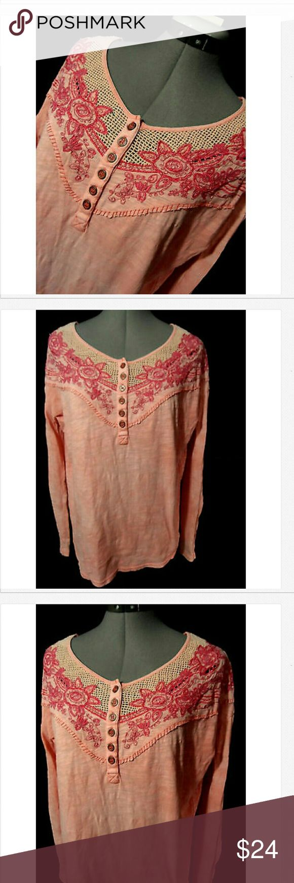 """FREE PEOPLE Crochet Henley Top XS Pink oversized Individual monitors may display slightly different colors or hues...   FREE PEOPLE Henley T-shirt  TAG SIZE: XS BUST: 46"""" LENGTH: 25"""" from nape down the back  Floral embroidered Roses yoke Henley 1/2 button front Scoop neck Lacy crochet inset front Slightly rounded tail Long sleeve Peachy Pink in color Light wash and wear, there is a pinhole in the back of the neck from a tag. Free People Tops Tees - Long Sleeve"""