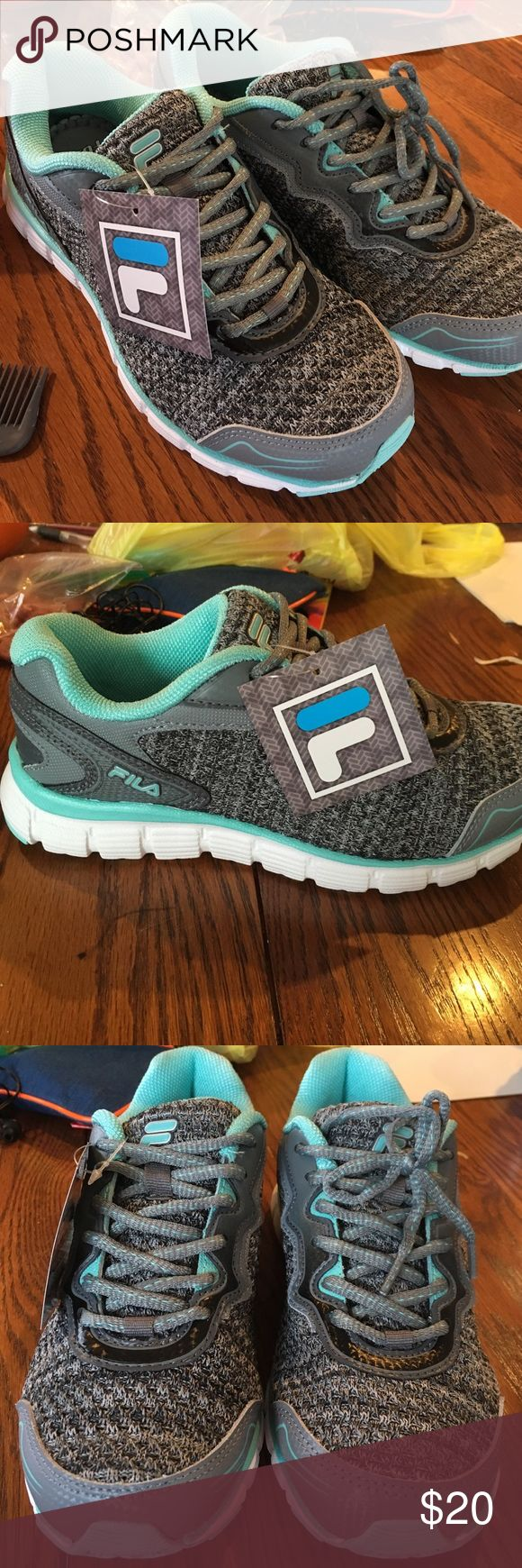 Size 7.5 fila running shoe Brand new with tag. Memory foam. Gray and aqua Fila Shoes Athletic Shoes