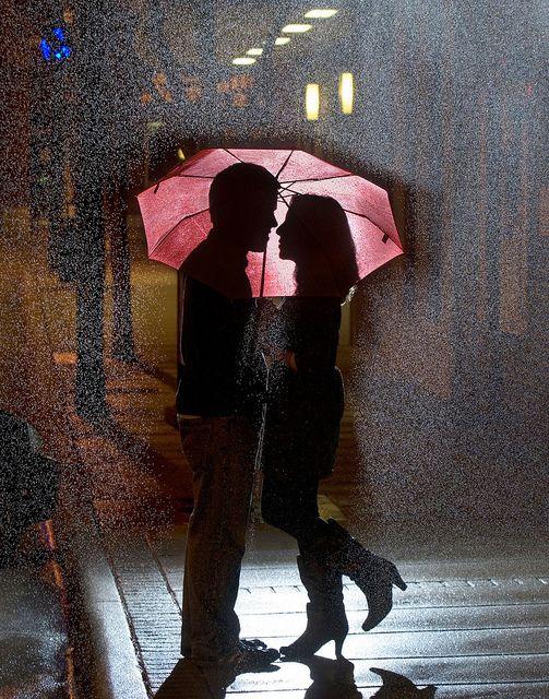 Romantic couples in the rain