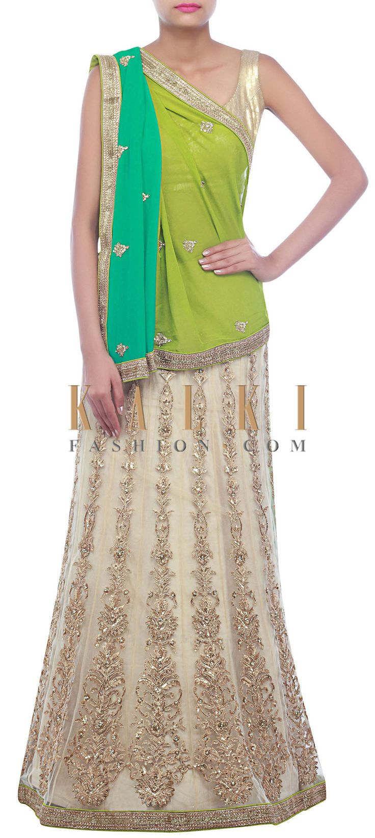 Buy Online from the link below. We ship worldwide (Free Shipping over US$100) http://www.kalkifashion.com/beige-and-green-lehenga-saree-embellished-in-zari-embroidery-only-on-kalki.html