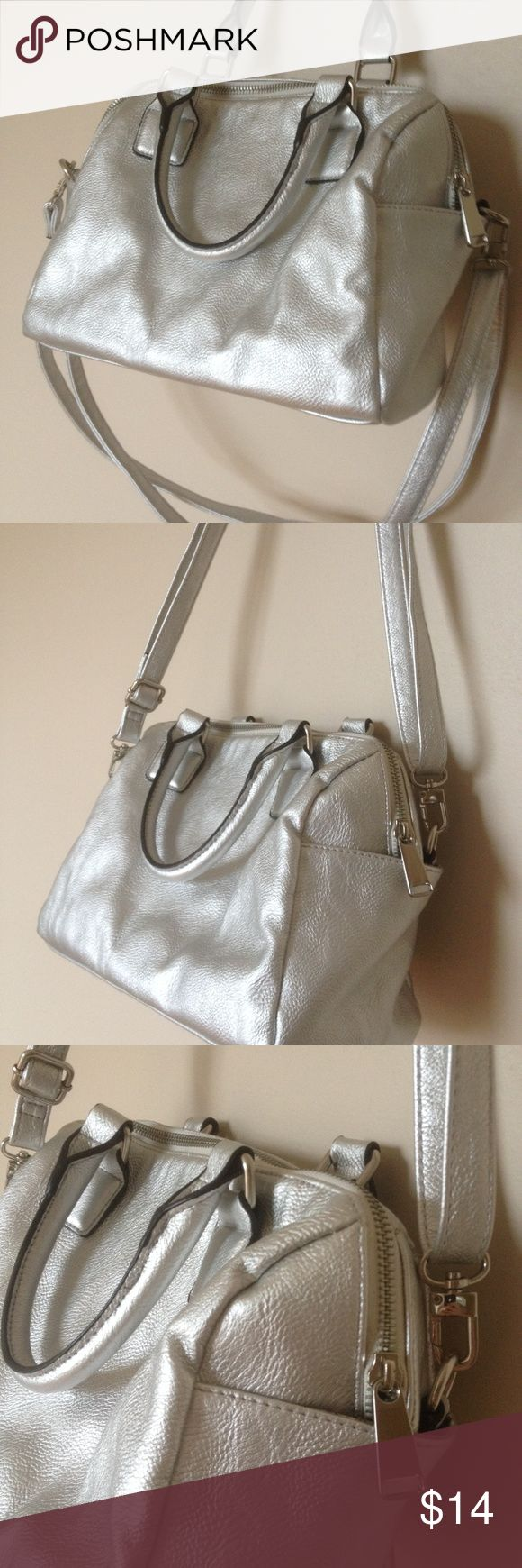 Silver Leather Purse Faux leather, satchel can be shoulder bag using handles or use long adjustable straps for crossbody or desired length, long straps can be un-clipped and removed, pretty interior with zippered and open pouches, large zipper closure, medium sized bag. In great condition other than two flaws - on the bottom of the bag (shown in photo #4) there is a place / spot on the leather, and the second flaw is shown in the last photo of discoloration on the interior (not exterior)…