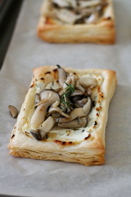 Oyster Mushroom Tart: herbed goat cheese baked on puff pastry and topped with oyster mushrooms sauteed in butter and herbs