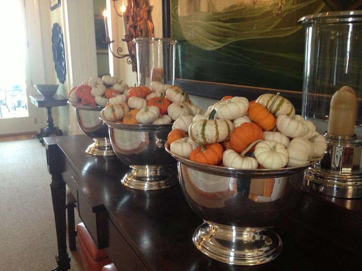 Pumpkins in silver punch bowls are a great way to mix rustic and sophisticated looks