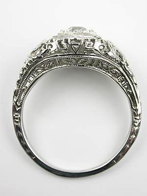 I love how low this is set...and how detailed the engraving is..Edwardian Antique Engagement Ring with Bird Motif