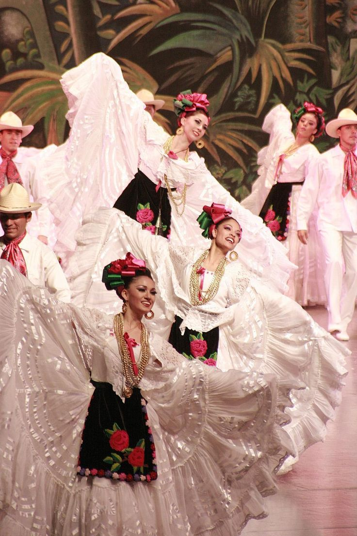 Ballet Folklorico de Amalia Hernandez - Jarocho. I wasn't lucky enough to wear one of these when I did baile folklorico as a kid. They are BEAUTIFUL! I want to have a collection of dolls dressed in traditional Mexican attire :}