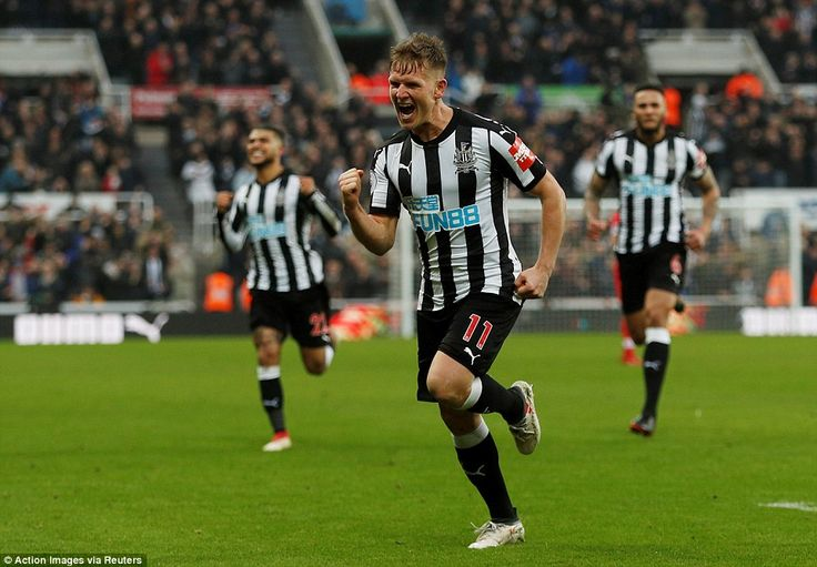 Ritchie put the result beyond all doubt as he celebrates Newcastle's third goal of the game with 30 minutes to play