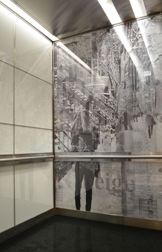 Artwork by Josh Nelson & Dominique Roberge is laminated behind glass in this Elevator Interior Design. Artwork : Street of Snow