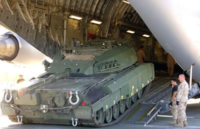 Canada acquired 120 Leopard 2 Tanks from the German and Dutch. A Canadian Leopard tank is driven off one our C-17 Globemasters. We should have got a better price (there was a glut of Leopard2/MBT on the market) however, we got them fast = another successful Harper procurement.