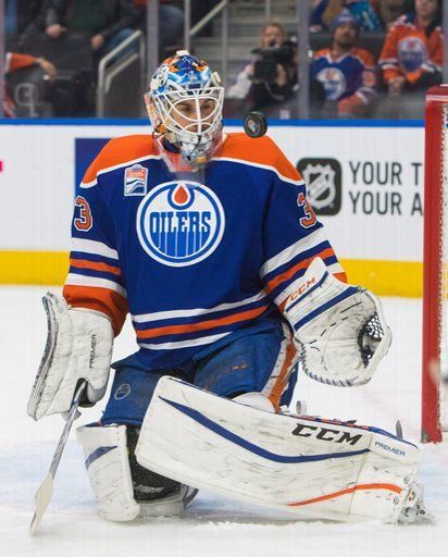 Edmonton Oilers' goalie Cam Talbot (33) makes a save against the Carolina Hurricanes during the first period of an NHL hockey game Tuesday, Oct. 18, 2016, in Edmonton, Alberta. (Amber Bracken/The Canadian Press via AP)