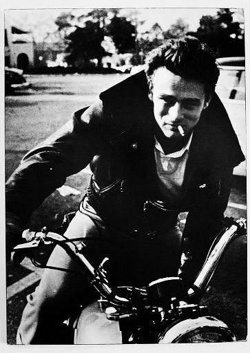 James Dean wearing a leather biker jacket. http://www.dazeddigital.com/blog/article/15976/1/the-biker-jacket