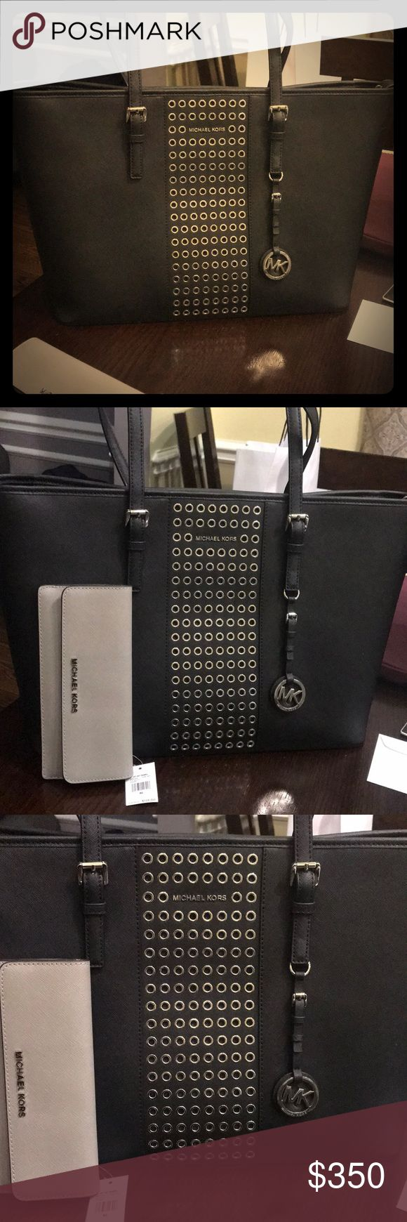 Large Michael Kors Tote With Pearl Grey Wallet New Large Black and Silver Tote Bag with Wallet Brand New Never Used Gorgeous - Selling this as a set Wallet and Purse No Trade. Michael Kors Bags Travel Bags
