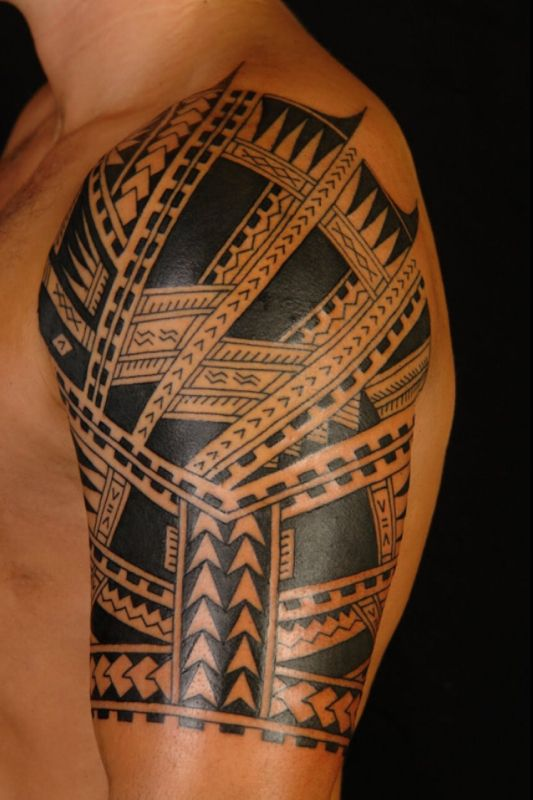 Tribal sleeve tattoo.