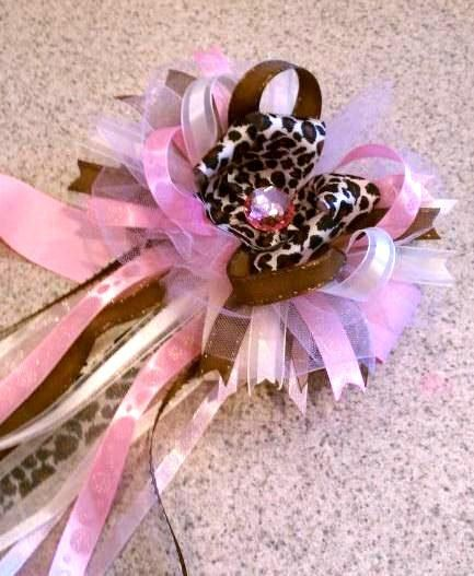 this listing is for a leopard themed baby shower corsage with layers of premium ribbons