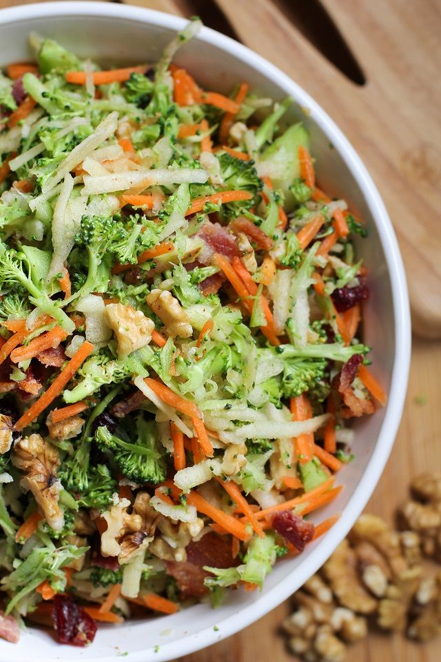 Grated Broccoli Salad with carrots, apples, dried cranberries, walnuts, and warm maple bacon dressing. #salad #recipe