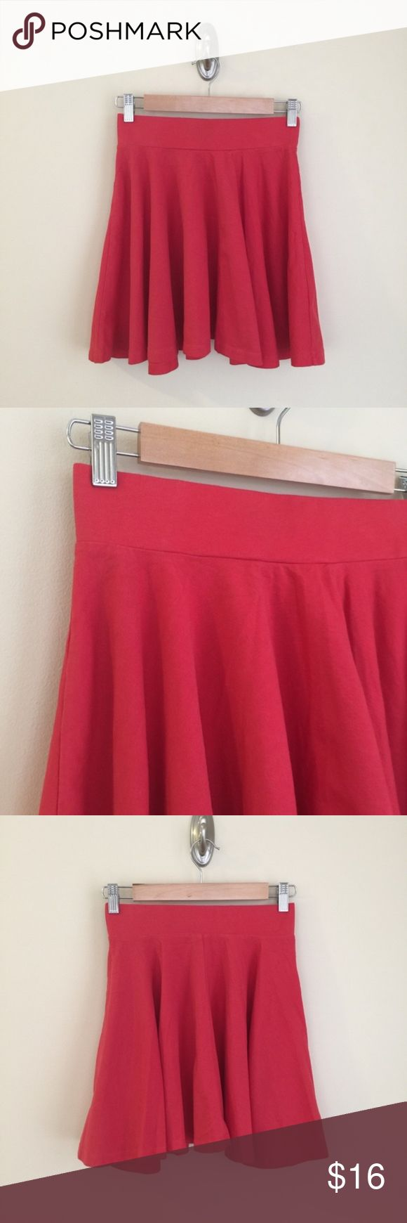 """Pins & Needles (UO) soft red skater skirt XS Super-soft stretchy material, wide elastic waistband, short length.  Size:  XS     Condition:  very good pre-owned, minor fading from normal wear.  Material:  95% cotton/5% spandex.    Measurements (approximate, taken laying flat):  length 17"""", flat waistband 12.5"""".  Bundle your likes for a custom private offer! Urban Outfitters Skirts Mini"""