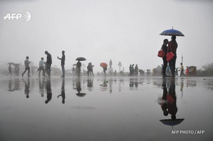 INDIA - Pedestrians walk with umbrellas during rainfall in Shimla. By @AFPphoto