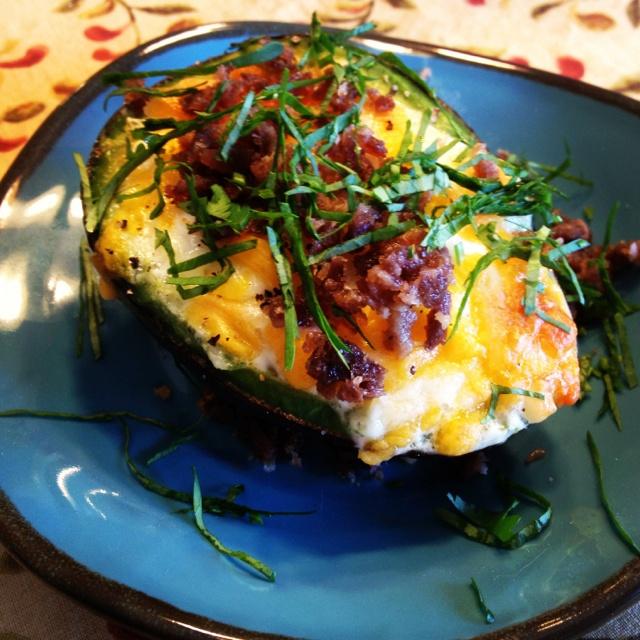 "My breakfast this morning 8.18.12 This is my interpretation of the ""Eggvocado"". Avocado, 1 egg, cheese, chopped steak, cilantro, salt & pepper.  Voila!  Eggvocado a la Blake."