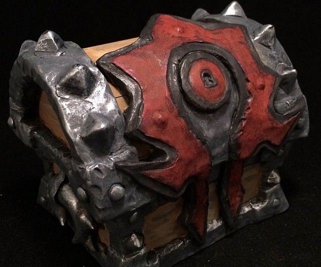 Pop the question to your significant other in true WoW fashion by storing the ring inside the World of Warcraft horde armory chest. The outside is modeled after the armory chests found in Azeroth while the inside features customized figures and unique detailing.