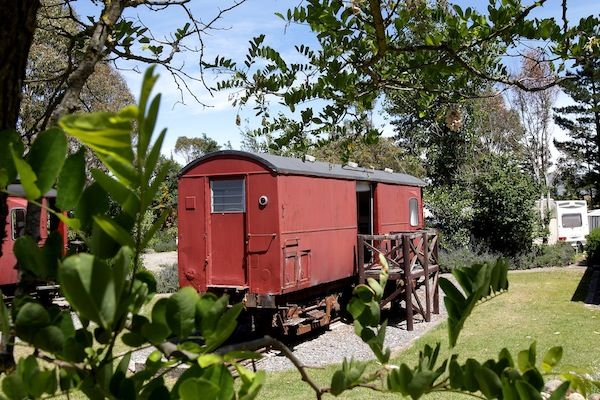 Sleep in a historic railway wagon at Waipara Sleepers or pitch your tent or park your van for the night. South Island,