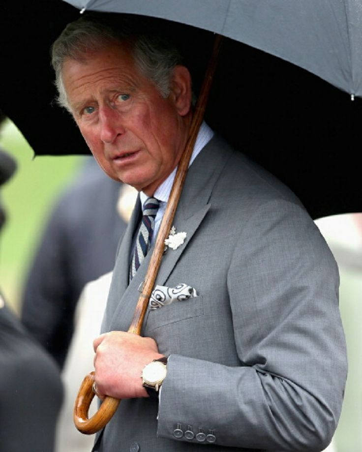 Prince Charles, Prince of Wales looks out from under his umbrella on Day 3 of a four day visit to Canada on 20.05.2014 in Charlottetown, Canada.