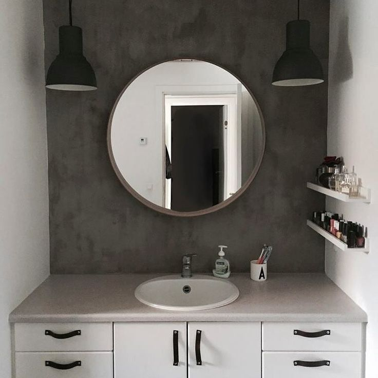 Bathroom make-over. Concrete look wall and Ikea Stockholm mirror + Hektar lamps