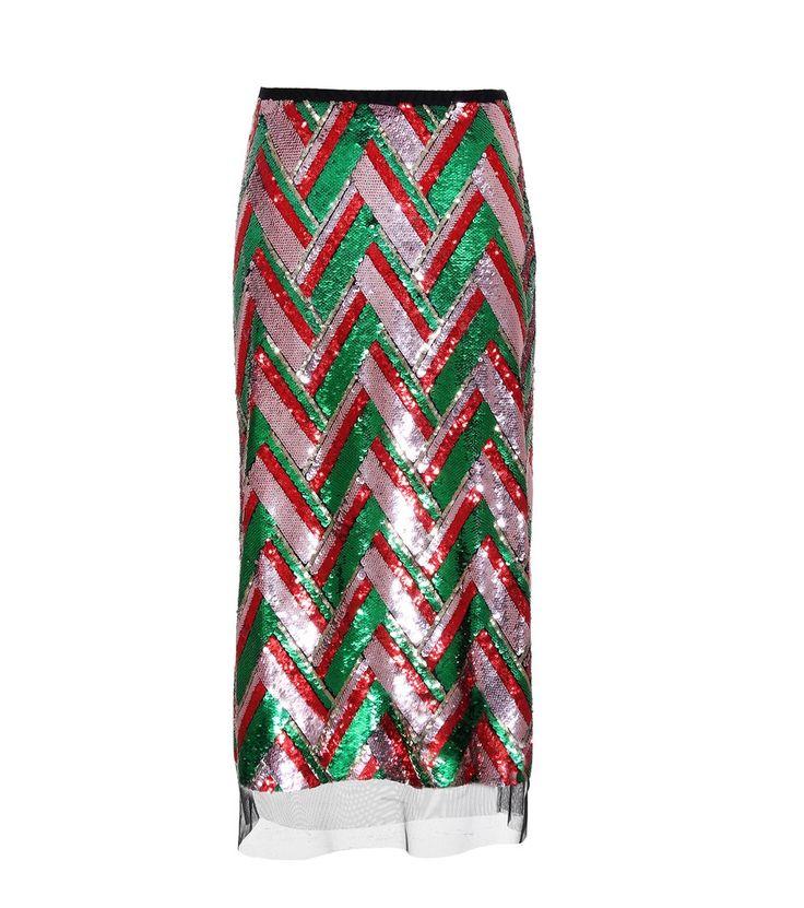 Gucci - Paillettenrock - Mit dem Bleistiftrock der italienischen Marke Gucci gelingt Ihnen ein aufsehenerregender Auftritt. Das Modell wurde in Italien aus zartem Tüll gefertigt, welcher mit schillernden Pailletten in diversen Größen bestickt ist. Das Zickzackmuster in den labeltypischen Farben wie Grün, Rot und Gold ist äußerst expressiv. Abgerundet wird das Design von einem schmalen Bund aus Ripsband. Lassen Sie sich vom Laufsteg-Styling inspirieren und kombinieren Sie dazu eine gepunktete…