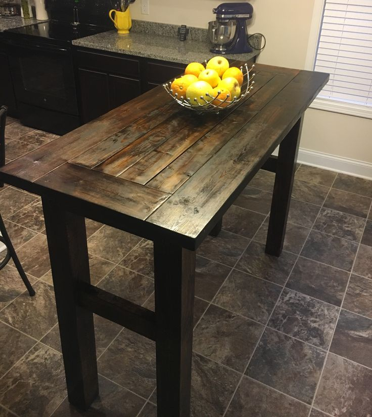 """Super simple pub table. 43"""" high, 60"""" long and 30"""" wide. Using 2-2x6, 2-4x4x8, 4-2x4, a kreg pocket hole drill, and some stain!  $40 for a beautiful, solid kitchen table."""