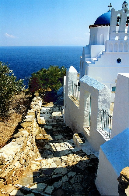 Alley and church  Church of Panagia Poulati and paved alley. Sifnos island, Cyclades, Greece