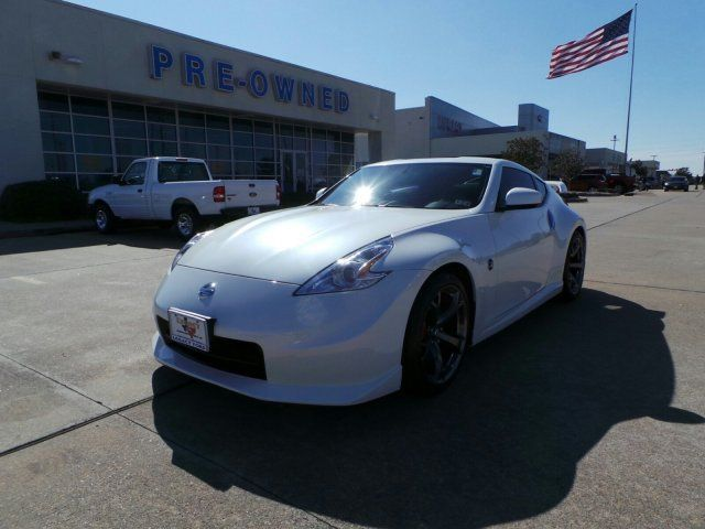 FOR SALE : 2013 Nissan 370Z Nismo, RWD with only 2,476 miles. Powered by a 3.7L Gas Engine and a 6 Speed Manual Transmission. Performance, Value and Great Gas Mileage all rolled into one 2 Door Sports Coupe. This Little Beauty is Priced to Sell @ $37,944. For more details visit us at http://cardealsguru.com/stock/140558A