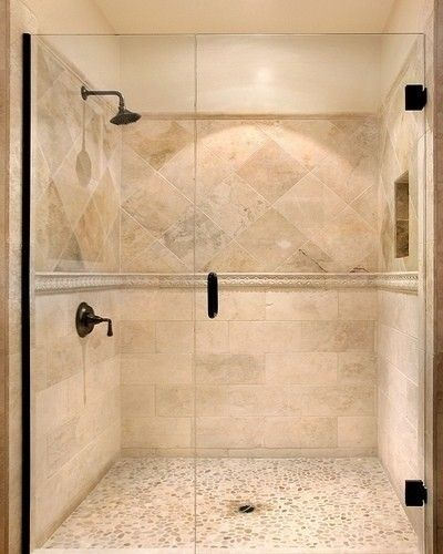 I like the idea of this shower. The penny/pebble floor, two different tile  designs on wall with band seperating - Travertine Shower Design with pebble  floor