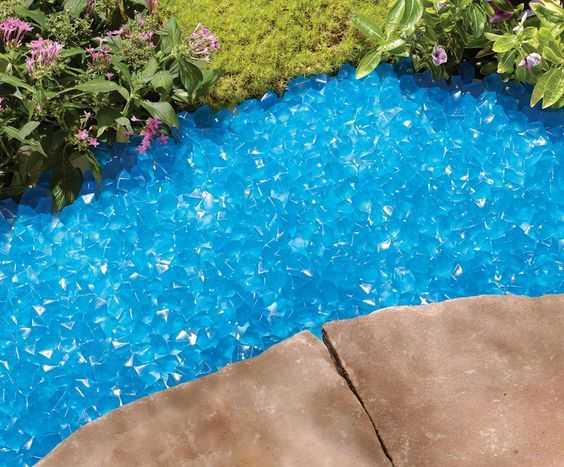 Blue Glow Stones: They soak up the sun and at twilight, release it to create a stunning lighting effect along a walk, around a tree, or to highlight other landscape features.