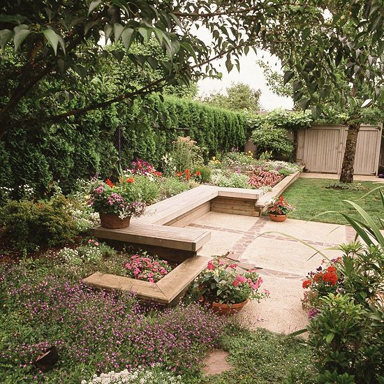 The concrete and brick used to create this handsome patio seating area are low-maintenance materials that resist the effects of wind, water, and temperature changes. The washed-aggregate surface of the concrete doesn't need sealing.