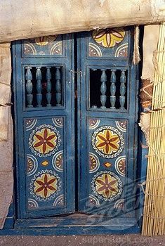 Close-up of decorated blue wooden doors to a yurt at Repeter, Turkmenistan | ©Robert Harding