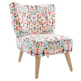Accent chair from Heal's covered in Malika Favre's Peacock fabric. Perfect for a bedroom
