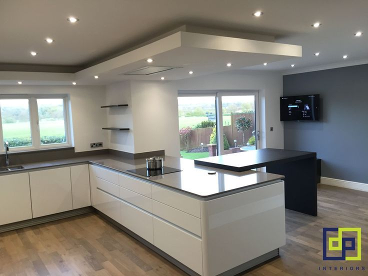 white gloss next 125 kitchen. Gris expo silestone worktops with dekton sirus tab